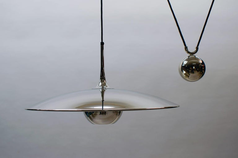 The Classic of Florian Schulz lamps.  Height variable by adjusting the weight from 80cm to 200cm.  Onos counter weight lamp. 1970s, brass with a very nice patina.