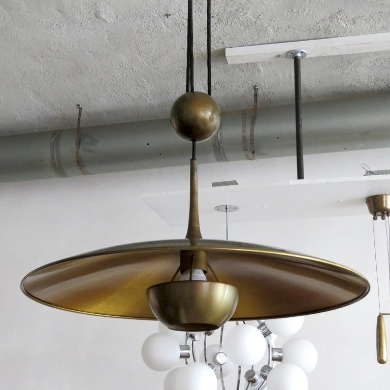 Wonderful large brass saucer pendant by Florian Schulz with central pulley mechanism, a heavy brass ball counter balances the weight of the fully adjustable shade.
