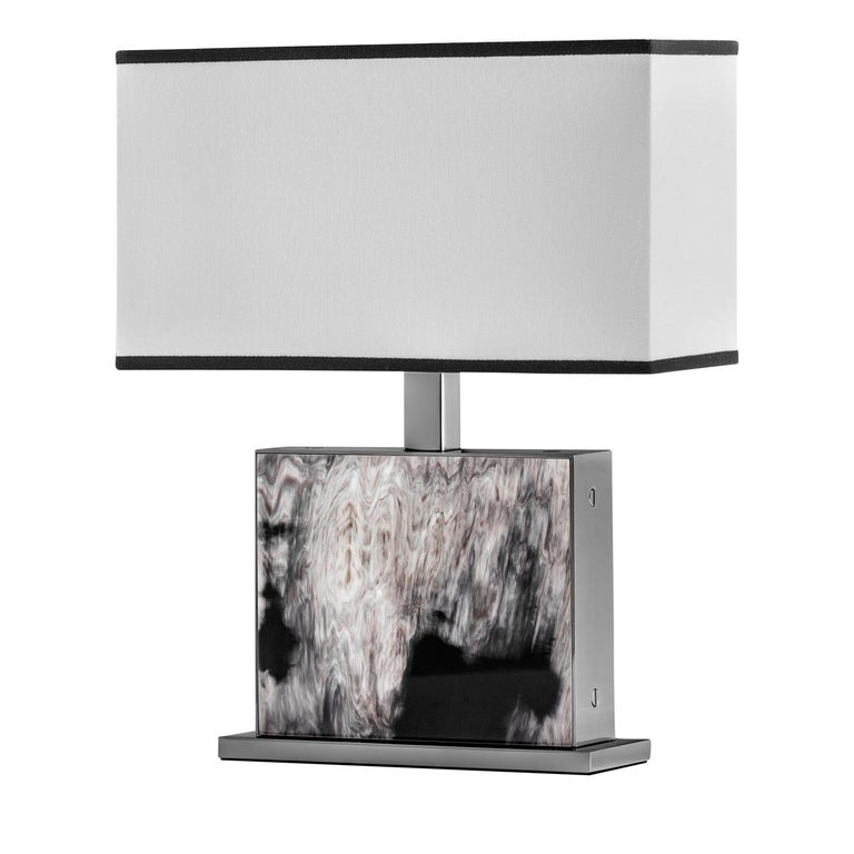 Eccentric and sculptural, this exquisite table lamp by Filippo Dini masterfully enhances the dark horn's natural veining, which is the focal element of this refined object. The supporting structure is also enriched by gunmetal brass details with