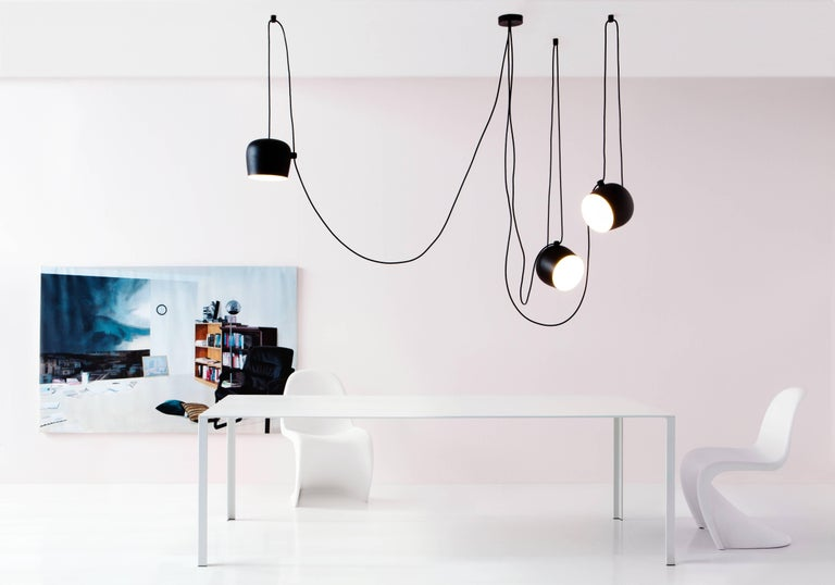 FLOS Aim Black Three-Lamp Light Set w/ Canopy by Ronan & Erwan Bouroullec  Created by the Bouroullec brothers in 2010, the AIM ceiling light is a design stripped to its most basic—and beautiful—essence. This innovative form of modern pendant