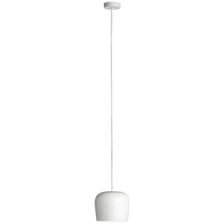 FLOS AIM Plug-In Pendant Light in White by Ronan & Erwan Bouroullec  Created by the Bouroullec brothers in 2010, the AIM ceiling light is a design stripped to its most basic—and beautiful—essence. This innovative form of modern pendant lighting is