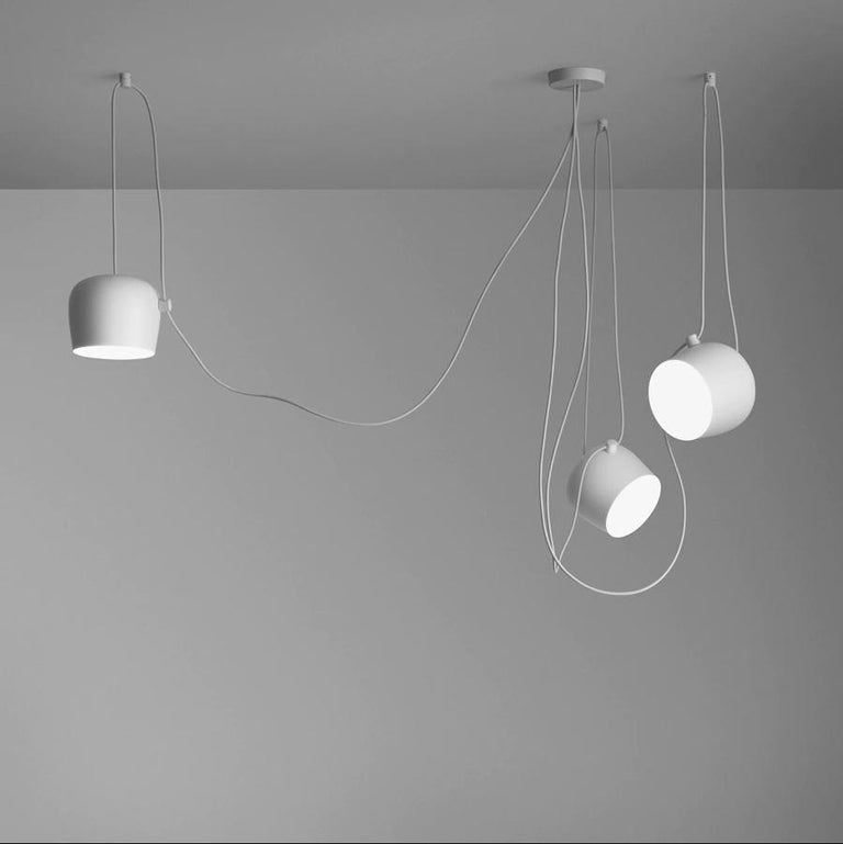Free Gift with Purchase if you Shop this Item! www. 1stdibs .com/info/gift-with-purchase/ Created by the Bouroullec brothers in 2010, the AIM ceiling light is a design stripped to its most basic—and beautiful—essence. This innovative form of modern