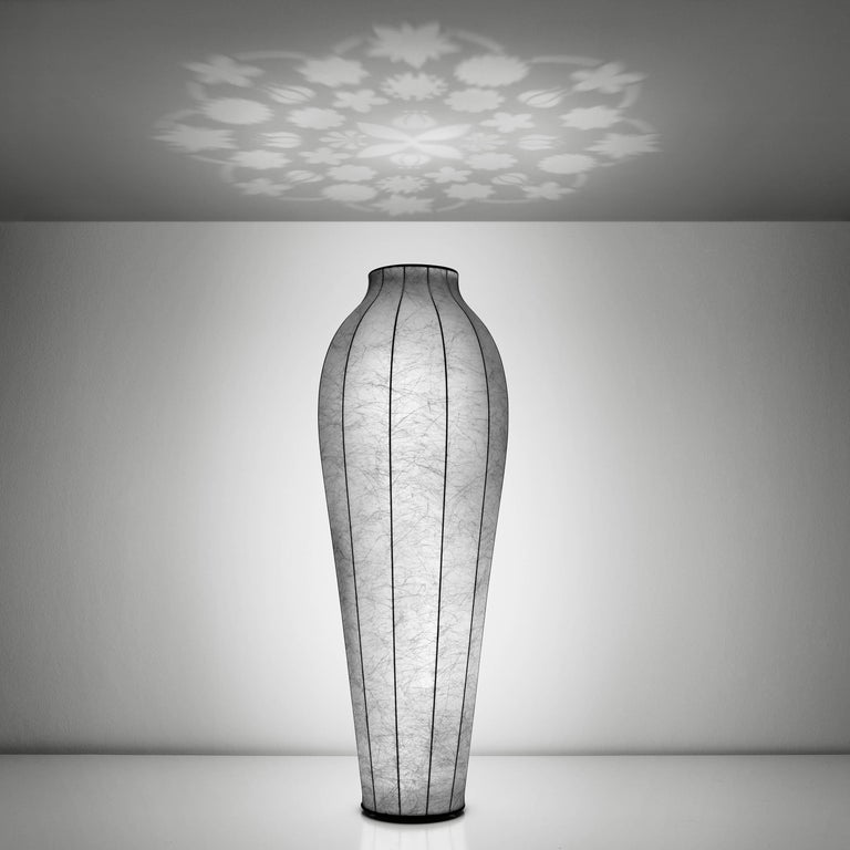 The chrysalis floor lamp was designed by Marcel Wanders in 2011.   The internal structure of the Chrysalis is made of steel. The