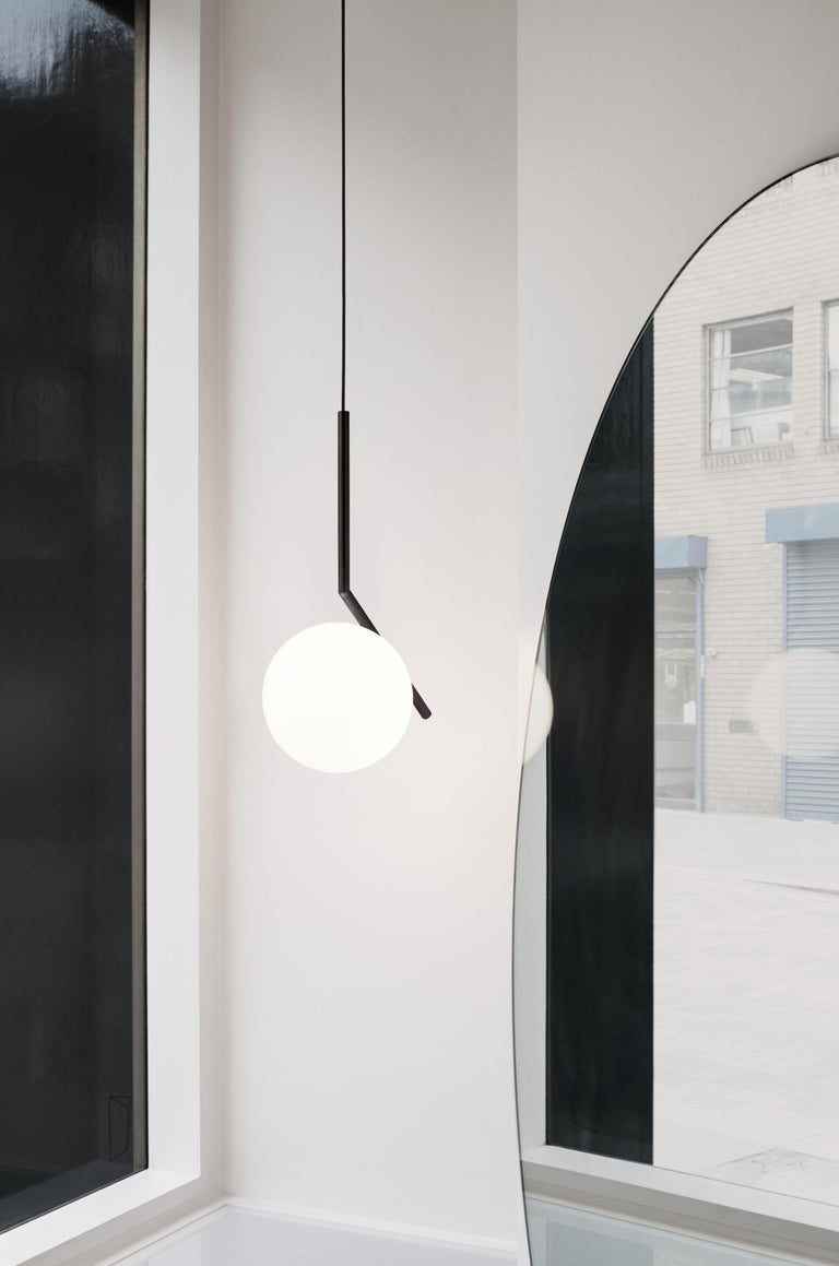 FLOS IC Lights S1 Pendant Light in Black by Michael Anastassiades  Like the other pieces in his IC Light Series, the IC Lights S balances designer Michael Anastassiades' love of industrial simplicity with intricate symbolism. Providing diffused