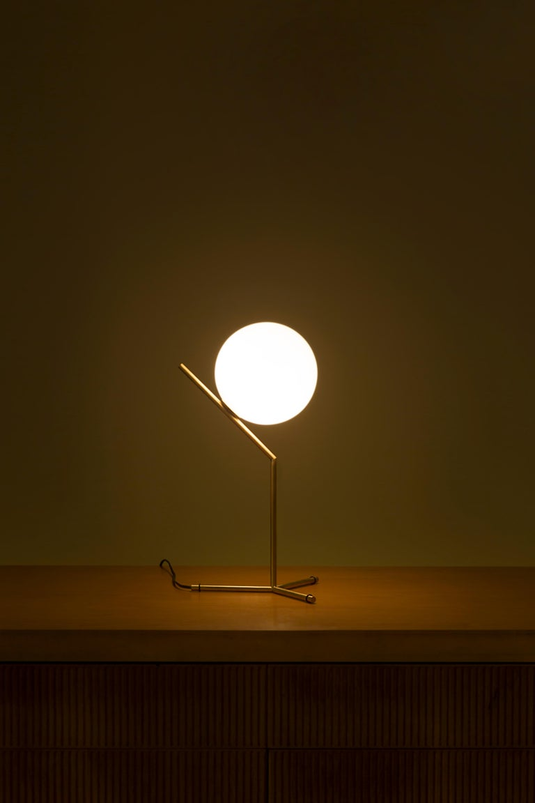 Like the other pieces in his IC Light Series, the IC Lights T balances designer Michael Anastassiades' love of Industrial simplicity with intricate symbolism. It provides diffused light through a mouth blown opaline sphere, which is held up by a