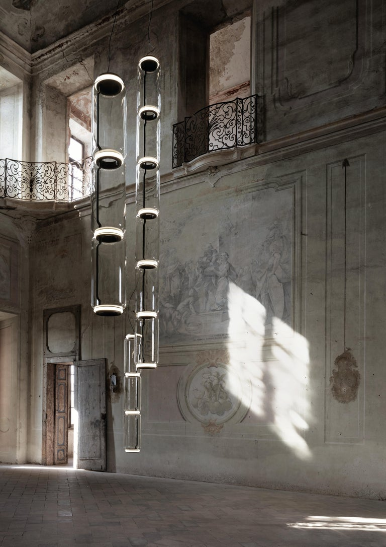 Noctambule LED dimmable pendant light short cylinders by Flos is the latest in the series of inventive lighting fixtures envisioned and executed by master designer Konstantin Grcic. This groundbreaking lighting system is made up of various units