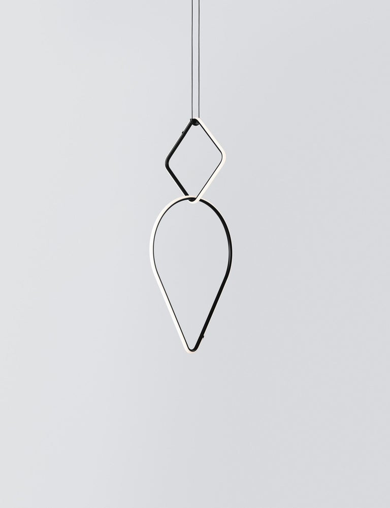 Arrangements is a modular system of geometric light elements that can be combined in different ways, creating multiple compositions into individual chandeliers. Each unit simply attaches onto the previous one as if resting, balancing perfectly as a