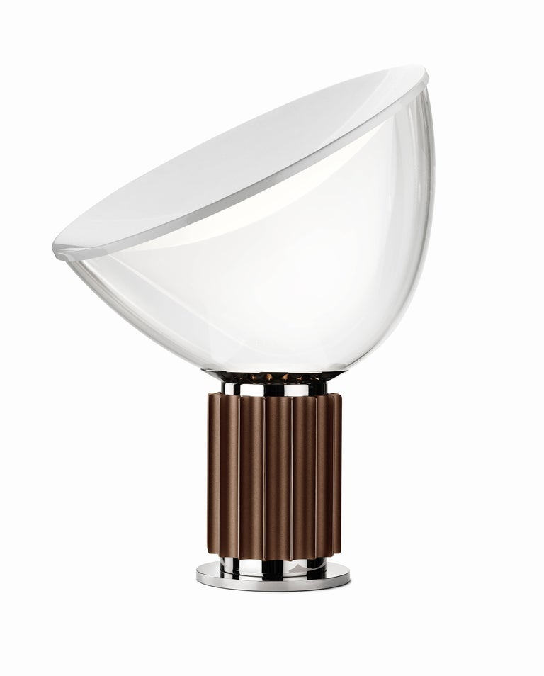 The Castiglioni brothers often created designs that challenged our perspective, and the Taccia, which gives the illusion of an upside-down hanging lamp, is an inspired example of that. Designed by the famed duo in 1962, the Taccia has a concave