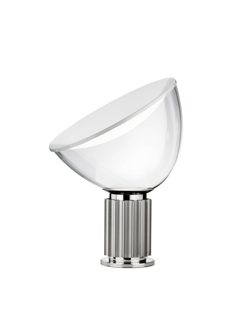 The Castiglioni brothers often created designs that challenged our perspective, and the Taccia, which gives the illusion of an upside-down hanging lamp, is an inspired example of that. This new, smaller version is approximately half the size of the