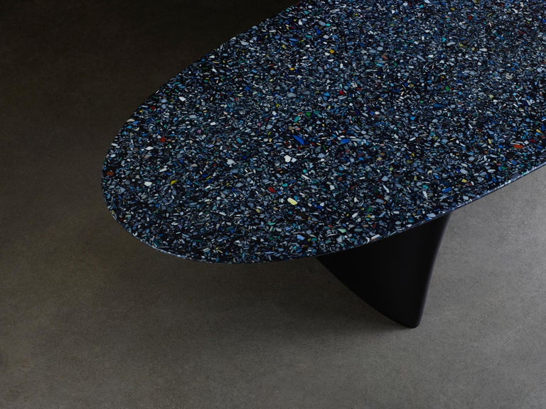 The Flotsam bench is produced using the innovative ocean terrazzo material developed by Brodie Neill using reclaimed and recycled fragments of ocean plastic. Cast completely as a singular piece by artisans in the UK, the bench seat takes its name