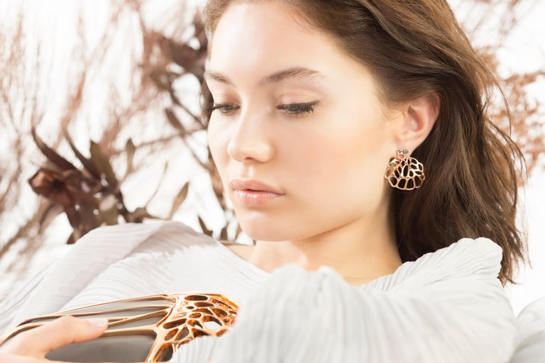 The AODA Studs and Ear Jacket Earrings are intended to recall fossils or futuristic organisms. The intricate geometry radiates a 3 dimensional suspended sculpture when worn. These visionary pieces, part objet d'art, part artifacts are digitally