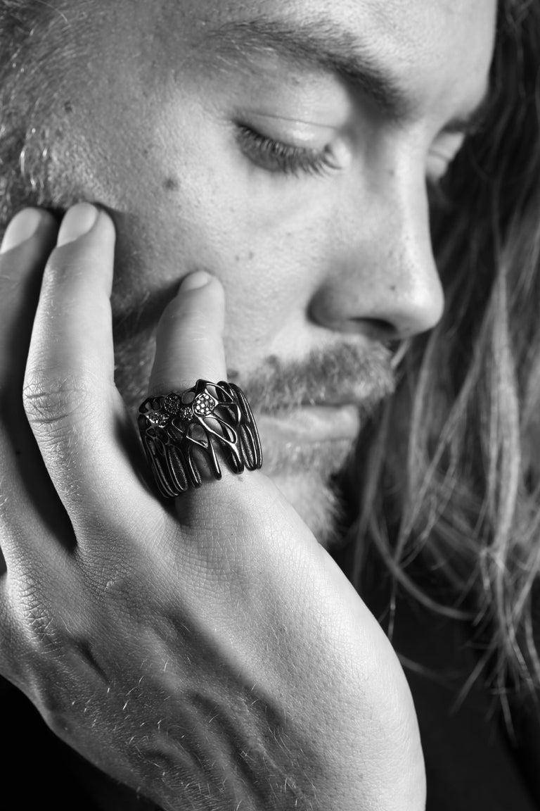 The MOXI Cocktail Ring is impossibly detailed, forming delicate webs that all at once seem half biological, half geological and all otherworldly. Thin ribs and loops seem to grow around diamonds like metal fingers of coral, turning in on themselves