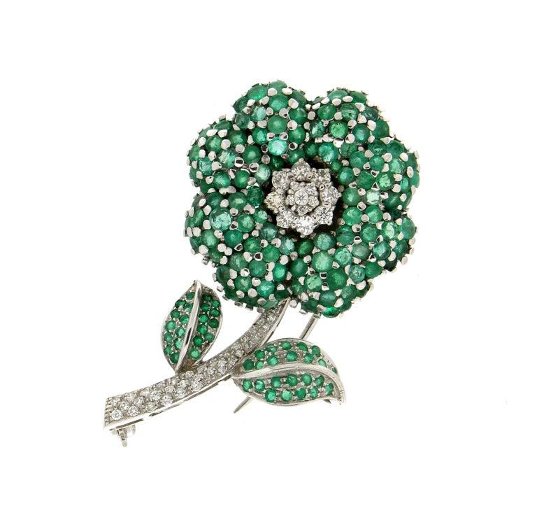 Flower 14 Karat White Gold Diamonds Emerald Brooch  Brooch total weight 17.50 grams Diamonds total weight 0.80 karat Emerald weight 8.59 karat