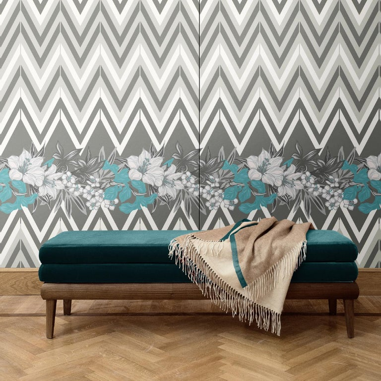 Combining the geometric pattern of chevron with the dynamic pattern of a garland of flowers, this wall covering creates a delicate design that is eye-catching and timeless. It was crafted of silk and cotton and is available as boiserie or fabric.