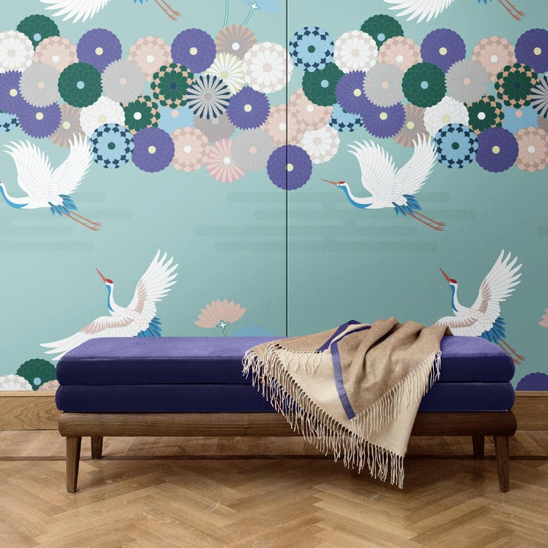 This elegant wall covering is part of the Flowers and Storks collection, inspired by the sophistication of traditional Japanese art. Over a delicate turquoise background, elegant storks fly, surrounded by stylized flowers in different shades. This