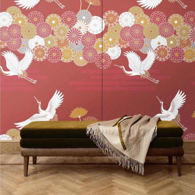 A superb homage to Japanese art, this wall covering is part of a series of five designs portraying storks and stylized flowers in different colors. In this case, the rich crimson is punctuated by white, gold, and pink colors for a warm and luxurious