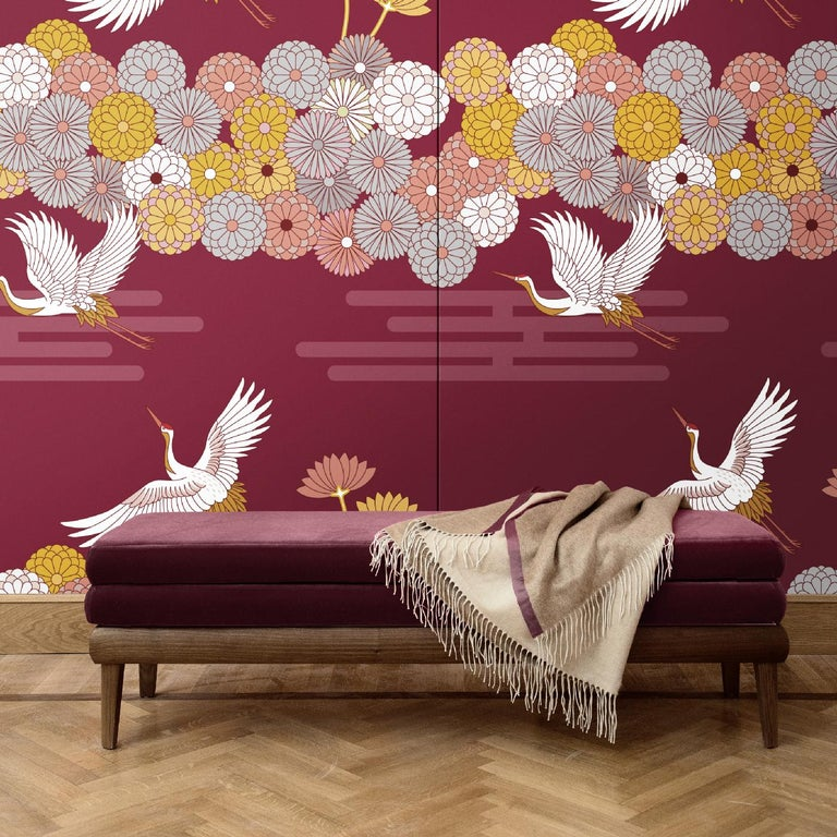 Crafted of silk and cotton, this wall covering is part of the Flowers and Storks collection. This Japanese-inspired scene will imbue with dramatic dynamism and sophistication any interior. It depicts golden storks and stylized flowers over a crimson