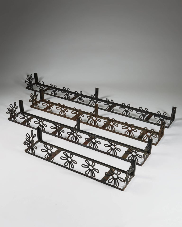 Flower boxes anonymous, Sweden, 1950s.  Forged iron.  Measures: Length of the largest 186 cm/ 6' 1'' Height 16 cm/ 6 1/4'' Depth 21 cm/ 8 1/4''  Length of the medium sized 146 cm/ 4' 9 1/2'' Height 16 cm/ 6 1/4'' Depth 21 cm/ 8