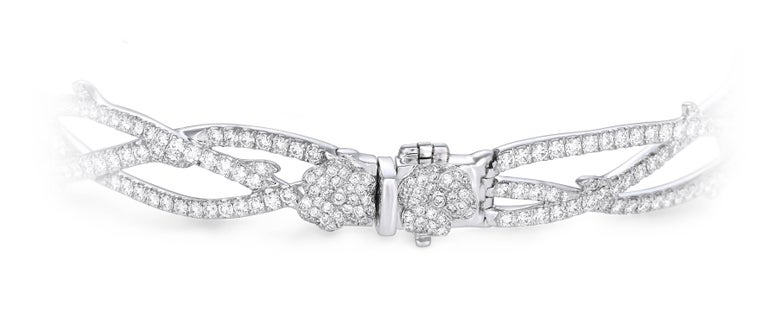 Contemporary Flower Bracelet crafted in 18K White Gold, Pink Sapphire, Ruby and Diamonds For Sale