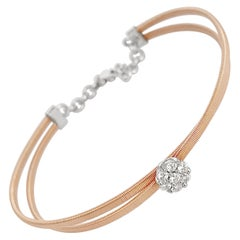 Flower Center of Round Brilliant Diamond and Rose Gold Cuff Bracelet