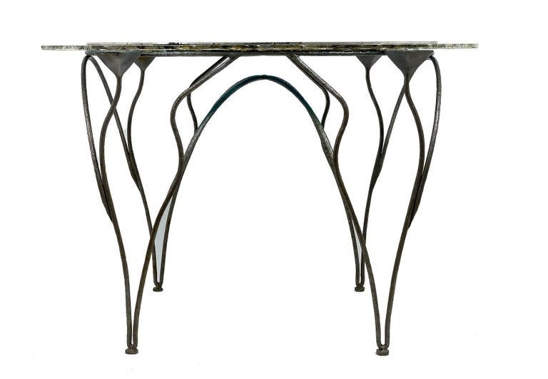 This console table is a sculpture décor object. The glass top is a combination of three silvered glasses. the central one is clear with irregular hand-made cut, silvered at the edge, this glass has two other glasses in acquamarina color, silvered