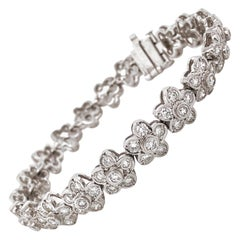 Flower Round Cut White Diamonds 7.79 Carat Platinum Link Bracelet