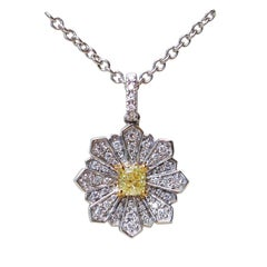 Flower Pendant with a 0.24 Carat Yellow Diamond and 0.24 Carat of White Diamond