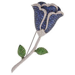 Flower Pin with Diamonds, Sapphire, and Tsavorite Garnet Set in 18 Karat Gold