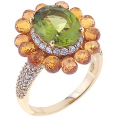 Flower Ring Gold with Oval Peridot, Orange Sapphires, and Diamonds