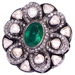 Flower Ring with Diamonds and Emerald in Center in Silver