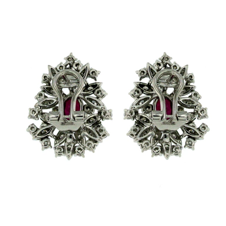 Vintage 18 karat gold Natural Ruby and diamond earrings.  These gorgeous ruby and diamond clusters feature 2 center Ruby that are 1.06 carats each, tot. 2.12 ct, along with a total diamond weight of 1,20 carats Round Brilliant Cut Diamonds graded G