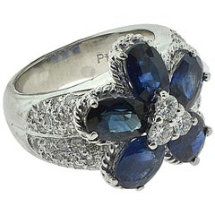 Flower Sapphire and Round Side Diamond Cluster Cocktail Ring in Platinum