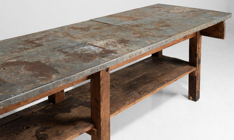 Primitive work table with zinc top on pine base.