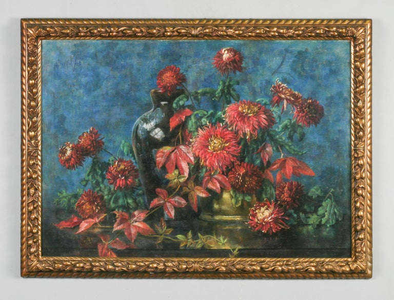 Large and beautiful pastel of an autumnal floral still life. red chrysanthemums and autumn leaves against a blue background.