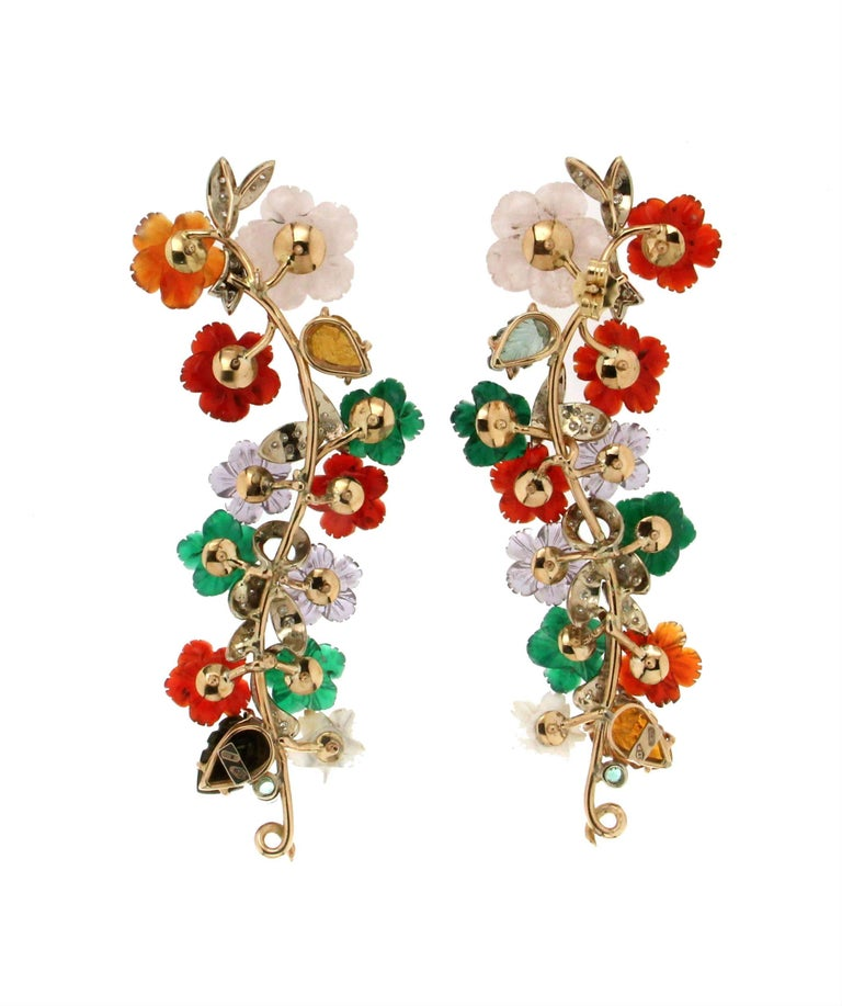 Flowers 14 Karat Yellow Gold Diamonds Stud Earrings. the flowers are composed of carnelian, mother-of-pearl, agate,tourmaline and amethysts  Earrings Gold weight 17.80 grams Earrings total weight 26.50 grams  Diamonds weight 0.80 karat Emeralds