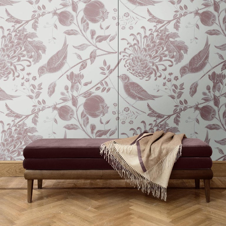 The mesmerizing design of this wall covering is part of the Flowers and Birds collection. In it, golden fruit, songbirds, and blooming dahlias add brilliance to a coral-hued background. This piece was crafted of silk and cotton and is available as
