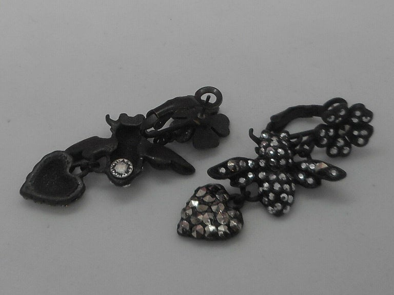 Signed Askew London Flowers, Bees and Hearts in Matt Black; set with Crystals. Pierced clip earring fittings. Earrings measure approx. 2.00'' X 0.75''.  Signed: Askew London. An Exciting Fashion Statement! Add your own Style and Pizzazz to any