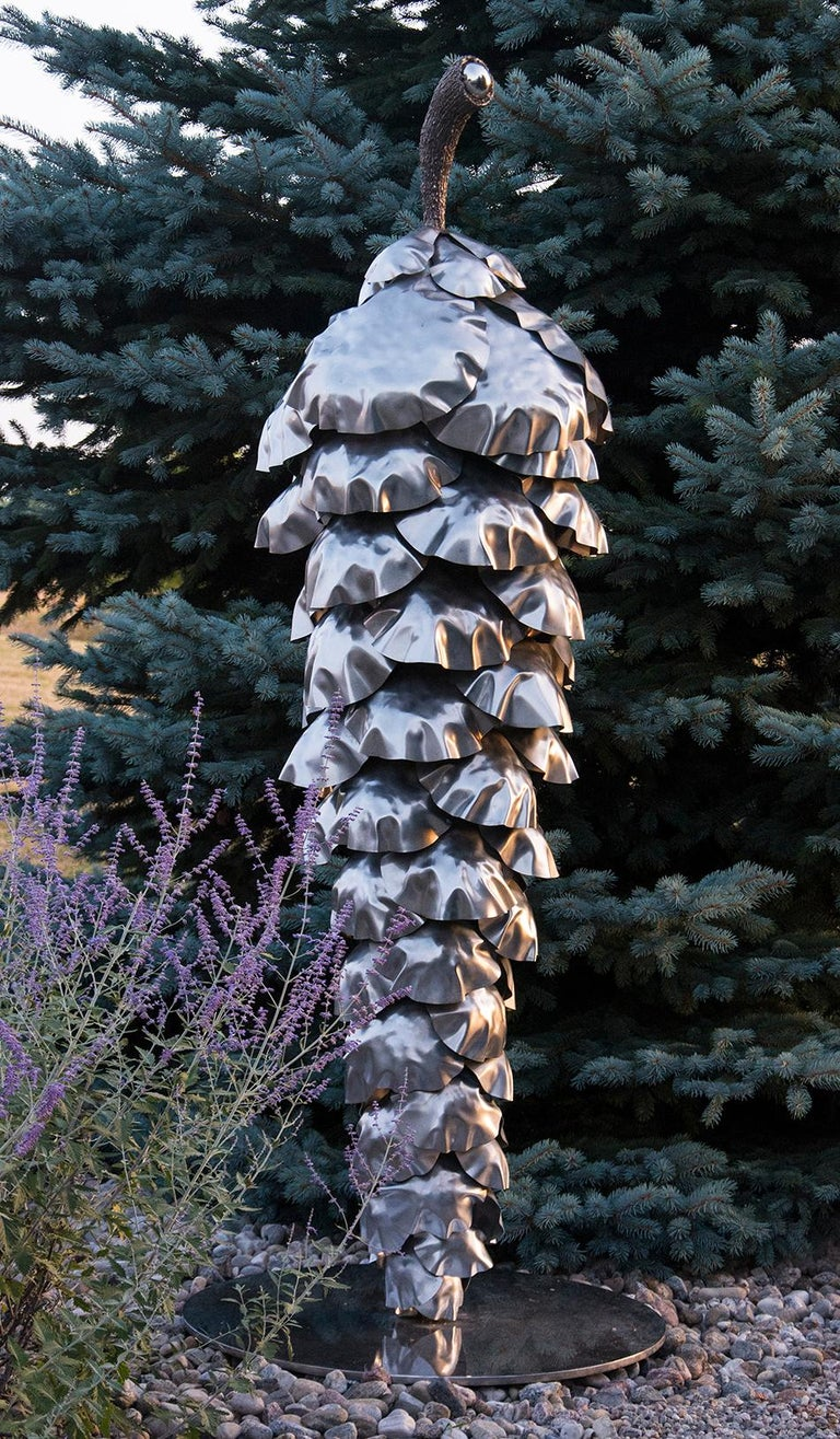 Canadian sculptor Floyd Elzinga merges iconic Canadian imagery with Pop art to create this statuesque outdoor pine cone.   From his studio on the Niagara Escarpment, Elzinga creates unique indoor and outdoor steel and bronze sculptures that resonate