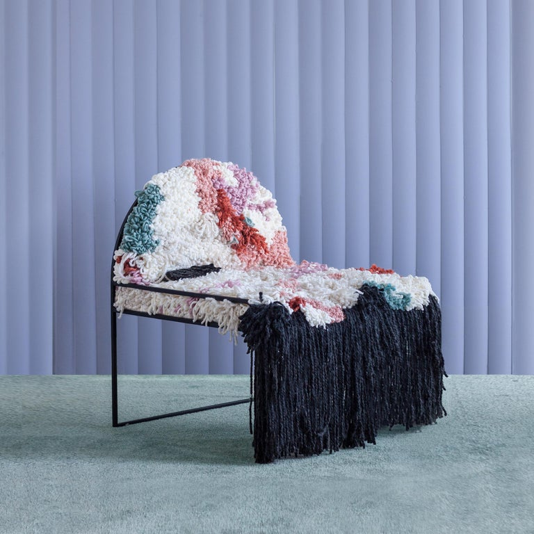 Thousands of organic yarn loops, individually hand-tied and knotted over long hours, form the playful soft seat of the sw chair in fluffy yarn. The hairy cushions are worn on a simple arched steel frame, bridging the slow, intricate, hand-worked
