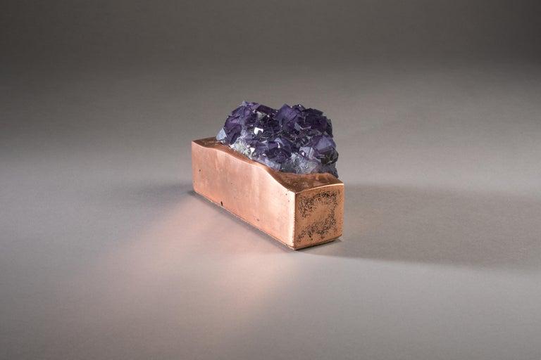 Fluorite on mirror polish copper base.