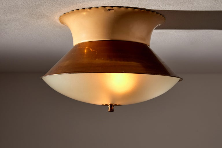 Flush mount ceiling light by Lumi. Manufactured in Italy circa 1950s. Opaline glass diffuser, brass armature and finial, enameled metal base. Rewired for US junction boxes. Takes two E27 25w maximum bulbs. Bulbs included as a one time courtesy.