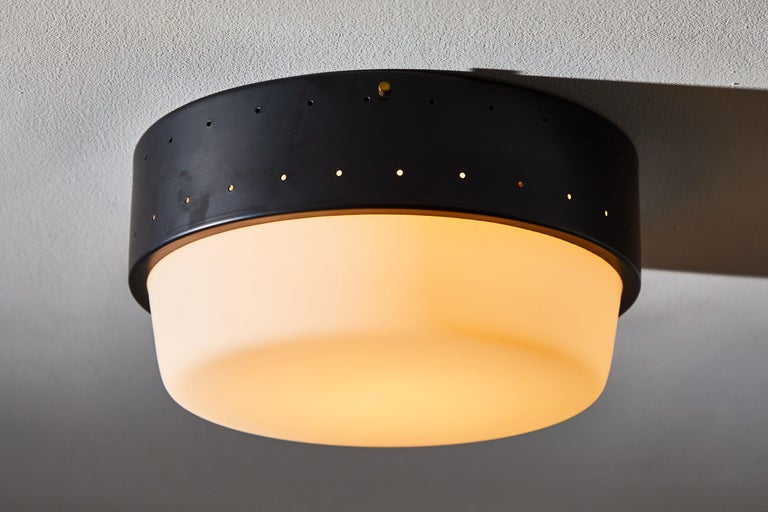 Flush Mount ceiling light by Stilnovo. Manufactured in Italy, circa 1960s. Enameled aluminium with brushed satin glass diffuser. Rewired for US junction boxes. Takes two E27 60w maximum bulbs.