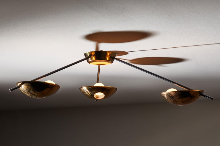 Three-arm flush mount ceiling light by Stilnovo. Manufactured in Italy circa 1950s. Brass with enameled metal armature. Rewired for US junction boxes. Takes three E27 25w minimum 60w maximum European candelabra bulbs. (Dependent on consumers