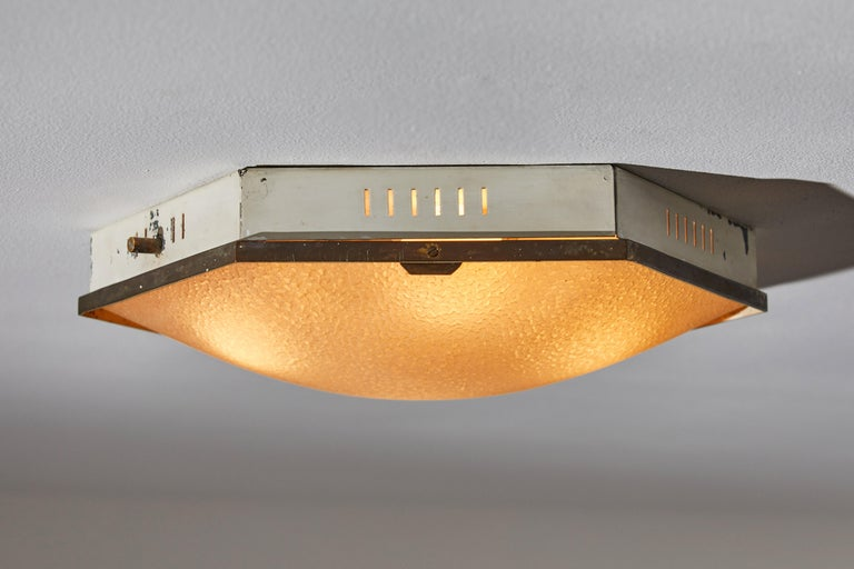 Flush mount ceiling Light by Stilnovo. Manufactured in Italy, circa 1950s. Enameled metal, bras textured glass. Rewired for U.S. junction boxes. Retains part of manufacturer's label. Bulbs provided as a onetime courtesy.