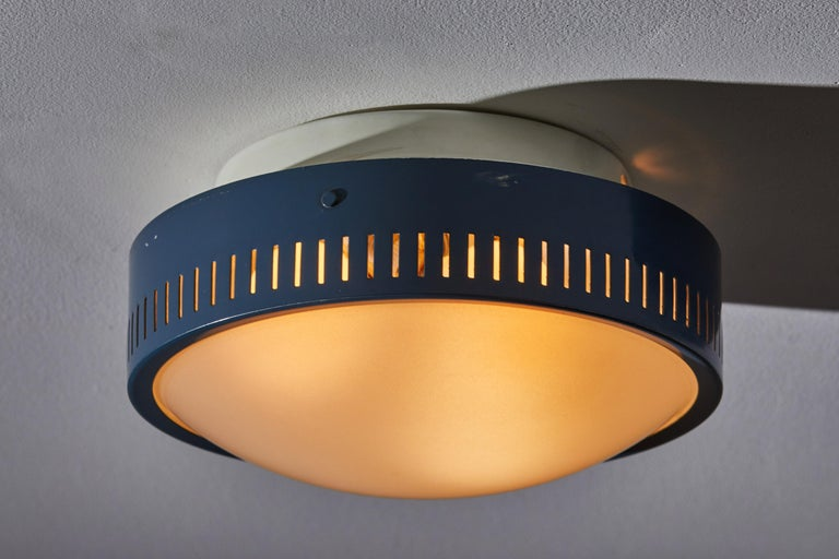 Flush mount ceiling light by Stilnovo. Manufactured in Italy, circa 1950s. Original enameled metal, opaline glass diffuser. Rewired for U.S. junction boxes. Takes three E27 60W maximum bulbs. Bulbs provided as a onetime courtesy.