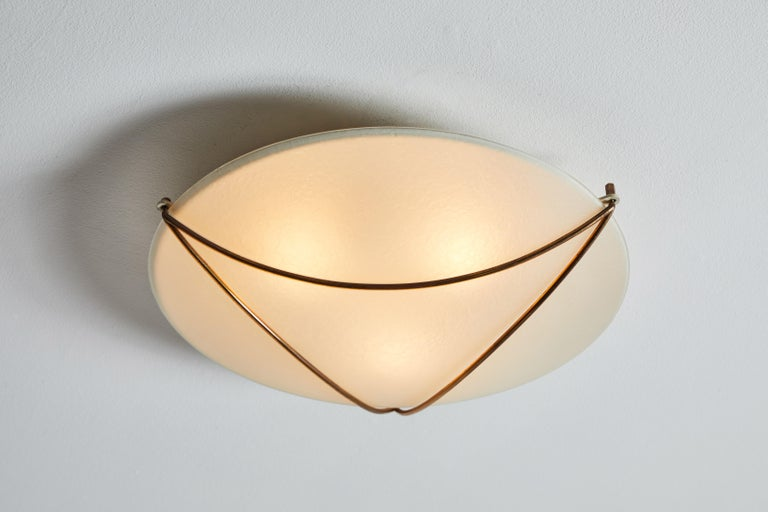 Flush mount ceiling light by Stilnovo. Manufactured in Italy, circa 1950s. Opaline glass and brass. Rewired for U.S. standards. We recommend three E26 25w maximum bulbs. Bulbs provided as a one time courtesy.