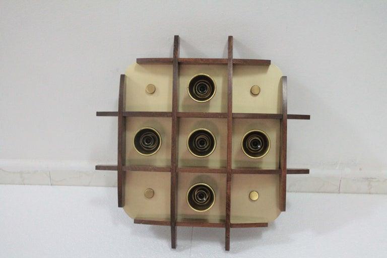 Wonderful wood flushmount by Esperia design Angelo Brotto. Good vintage condition.