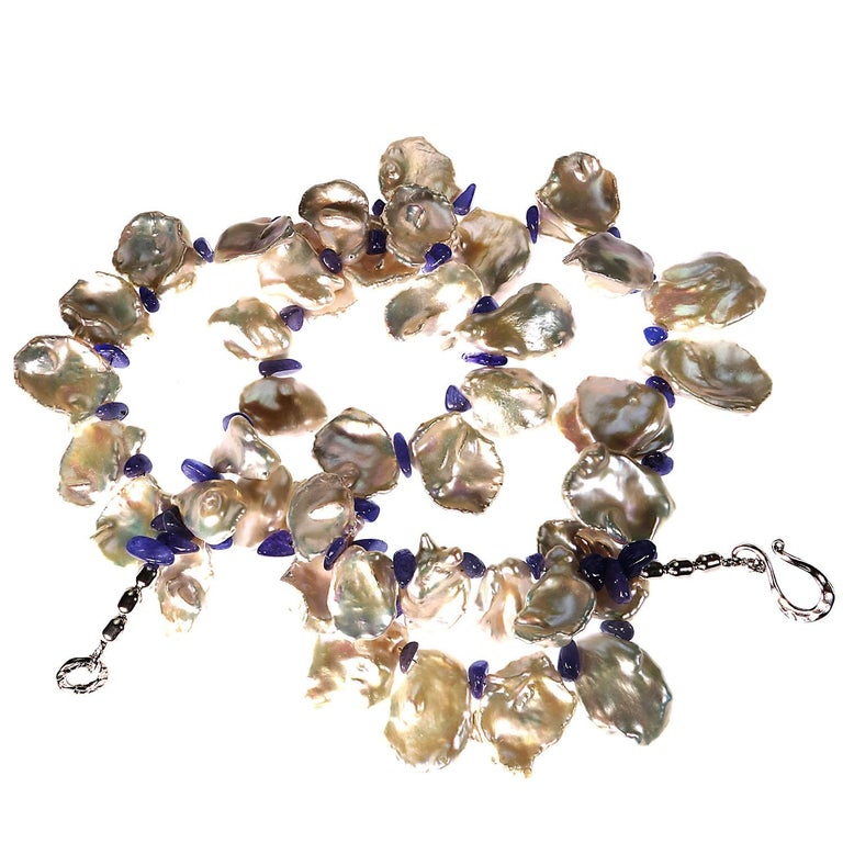White and Blue, custom made Pearl necklace!  Perfect for Spring.  Wear these lovely large iridescent Keshi Pearls and Tanzanites with everything.  They will enhance your entire wardrobe.  The highly polished tumbled Tanzanites  are truly an