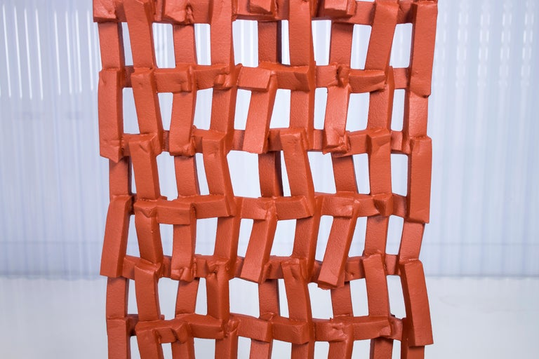 Foam Fences_S_Room Divider is Presented by Anton Hendrik Denys  The Foam Fences_S_Room divider is a narrow foam-coated screen with a closed-off pattern. It can be installed vertically or horizontal and comes with a set of metal hooks, offering an