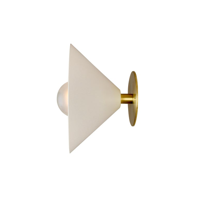 The focal point wall sconce packs a big design punch in a compact package. The focus family of products, designed in 2019 by Blueprint Lighting, features clean, handsome lines that work well in modern or traditional interiors.  The fixture's